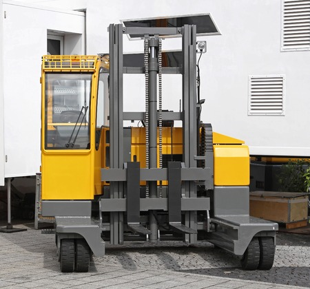 Side loader forklift for distribution warehouse Stock Photo