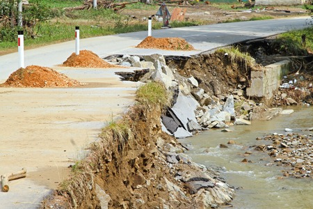landslip: Dangerous side of local road destroyed by erosion Stock Photo