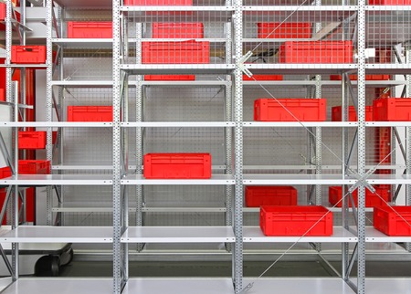 storage warehouse: Red boxes and crates at shelves in distribution warehouse