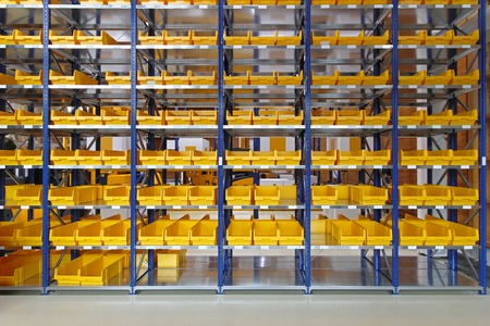 Storage trays and bins in distribution warehouse Stock Photo
