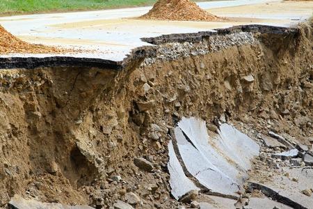 landslip: Dangerous part of landslip road section after flooding