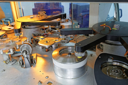 Compact disc and DVD manufacturing machine Stock Photo