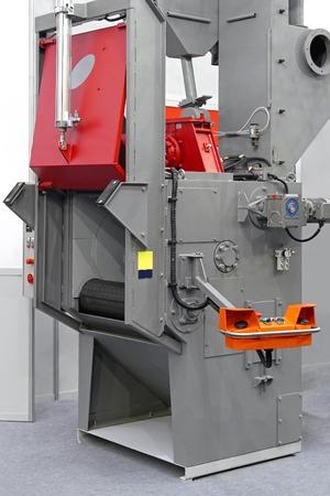 chamber: Automated sand shot blaster industrial equipment machine Stock Photo