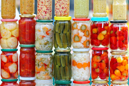 food storage: Pickled vegetables in mason jars ready for winter