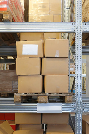 merchandise: Shelves loaded with merchandise in distribution warehouse Stock Photo