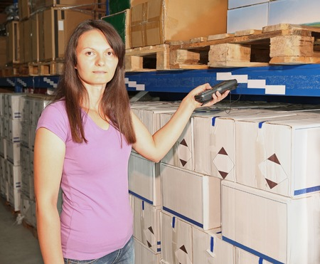 barcode scanner: Woman holding barcode scanner for warehouse management solutions