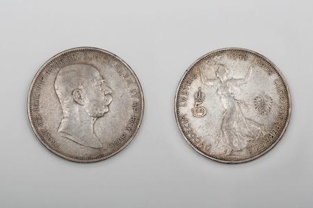 reign: BELGRADE, SERBIA - MAY 16: Franz Joseph Austrian coins in Belgrade on MAY 16, 2014. 5 Korona silver coin for 60th anniversary reign in Belgrade, Serbia. Editorial
