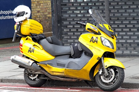 road assistance: LONDON, UNITED KINGDOM - APRIL 04: AA scooter in London on APRIL 04, 2010. Yellow AA scooter for road assistance in London, United Kingdom.