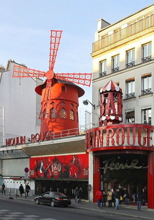 moulin: PARIS, FRANCE - JANUARY 5: Moulin Rouge Cabaret on JANUARY 5, 2010. Big Red Windmill Landmark famous for can can dance at Pigalle in Paris, France. Editorial