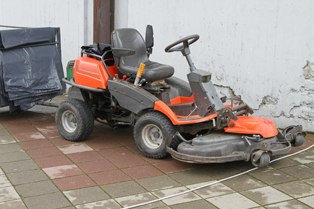 petrol powered: Big red petrol powered riding lawn mower