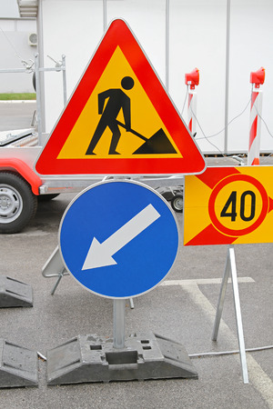 signaling: Road works traffic sign and direction arrow