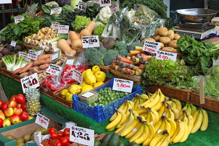 Fruits and vegetables at farmers market stall photo