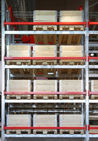 duties: Wooden shipping boxes with pallets in warehouse shelving