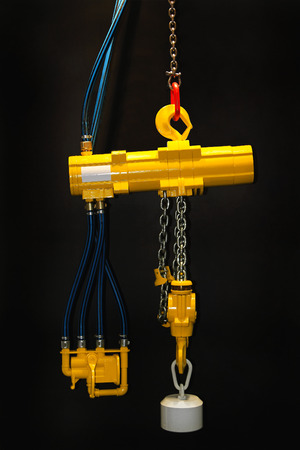 overhead crane: Pneumatic powered air hoist overhead crane Stock Photo