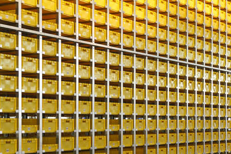 crates: Yellow plastic crates in distribution warehouse