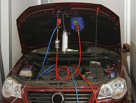 test equipment: Servicing air conditioner in auto repair shop Stock Photo