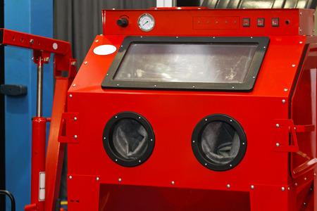 Sandblasting cabinet in auto repair garage service
