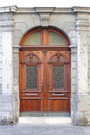 large doors: Double wooden door with arch