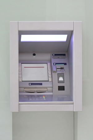 cashpoint: Modern automated teller machine at building exterior Stock Photo