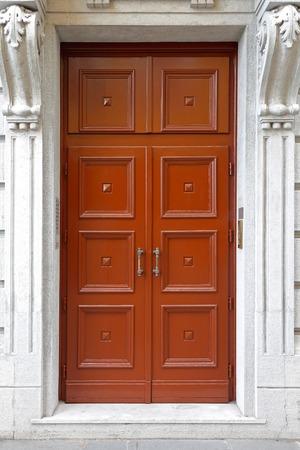 large doors: Closed big brown double door at building