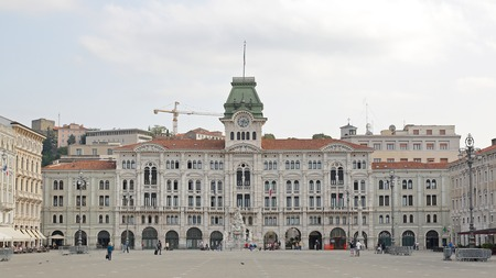 municipal editorial: TRIESTE, ITALY - OCTOBER 13: Unity of Italy Square in Ljubljana on OCTOBER 13, 2014. Main Great Square of Italian Unity with municipal building in Trieste, Italy.