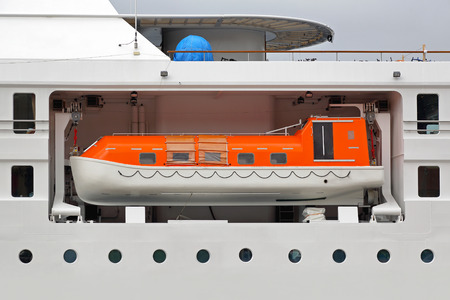 rigid: Enclosed lifeboat on a big cruise ship