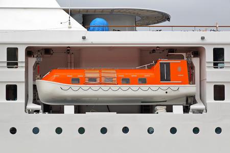 enclosed: Enclosed lifeboat on a big cruise ship