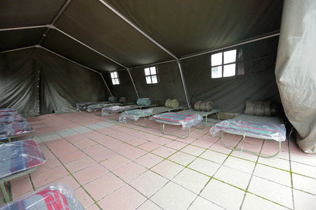 temporary: Tent shelter with temporary beds ready for natural disaster refuges Stock Photo