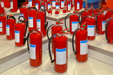 first responder: Big collection of various fire extinguishers in red