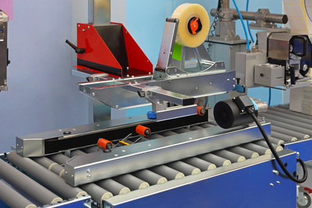 packaging equipment: Automatic packing machine for boxes in factory Stock Photo
