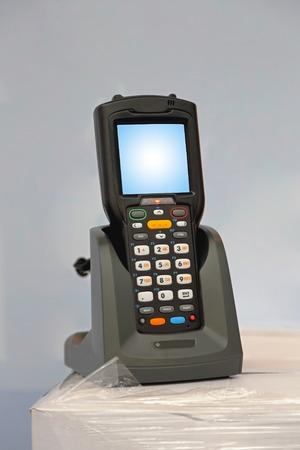 Handheld laser barcode scanner reader at charger dock