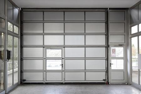 Sectional motorized big metal garage door