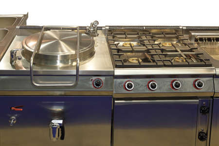 oven range: Commercial pressure cooker and big gas range in professional kitchen