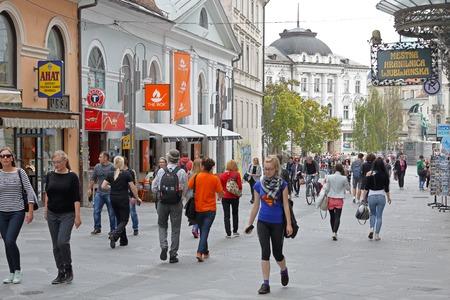 walking zone: LJUBLJANA, SLOVENIA - OCTOBER 13: Pedestrians at Copova street in Ljubljana on OCTOBER 13, 2014. People walking at pedestrian zone in Ljubljana, Slovenia.