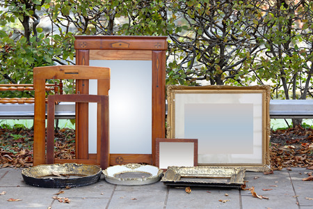 Picture frames and mirrors for sale at flea market photo