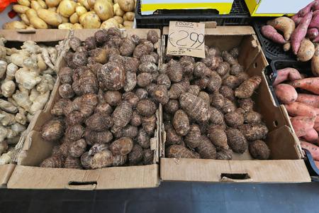 Eddoe tropical vegetable at farmers market photo