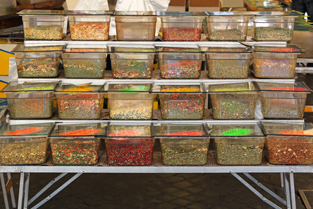Herbs and spices in bulk boxes at Rome market photo