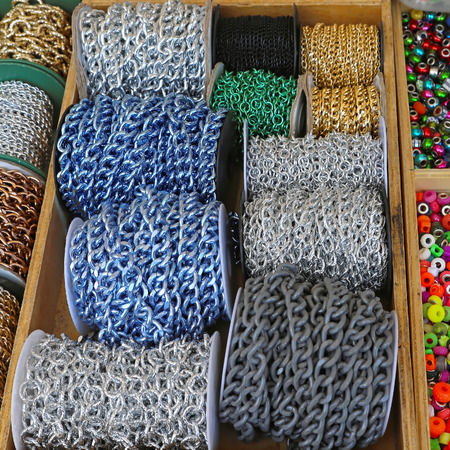 bijoux: Decorative metallic chains at reels for jewellery making