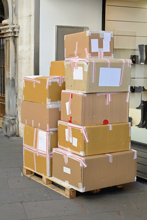Merchandise in boxes at pallet delivery in front of shop photo