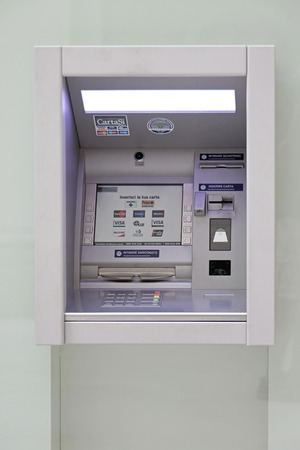 bancomat: TRIESTE, ITALY - OCTOBER 14: Automated teller machine in Trieste on OCTOBER 14, 2014. Atm at window of Bank Fideuram in Trieste, Italy.