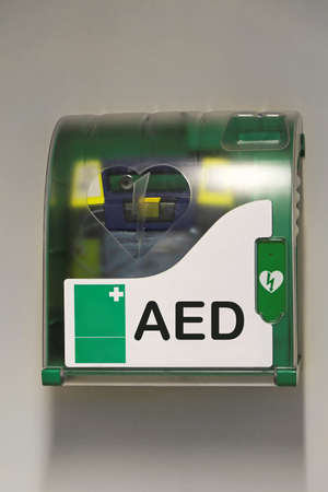 external: Automated external defibrillator emergency device at wall