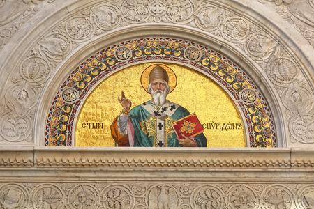 cristian: TRIESTE, ITALY - OCTOBER 14: Saint Spyridon mosaic in Trieste on OCTOBER 14, 2014. Fresco icon of St. Spiridon at Serbian Orthodox Parish in Trieste, Italy. Editorial
