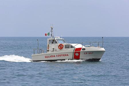 tyrrhenian: AMALFI COAST, ITALY - JUNE 28: Guardia Costiera in Amalfi Coast on JUNE 28, 2014. Coast Guard boat patroling at Tyrrhenian sea in Amalfi Coast, Italy.