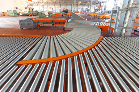sorting: Conveyer roller sorting system in distribution warehouse