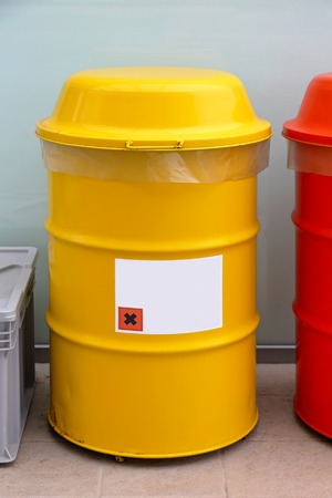 hazardous waste: Yellow barrel for dangerous and hazardous waste disposal Stock Photo