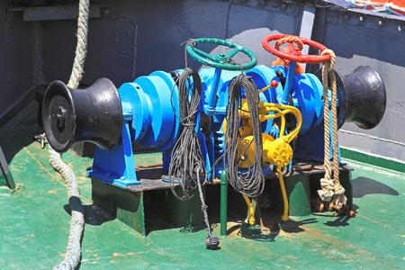 tug boat: Hydraulic anchor windlass at small tug boat Stock Photo