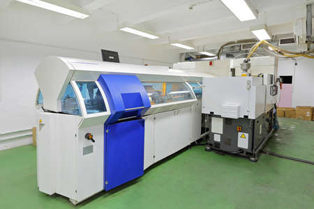 compact disc: DVD and compact disc manufacturing machine in factory