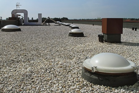 roofing: Flat roof with gravel and sky light windoows