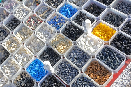 Various small plastic parts in trays Stock Photo