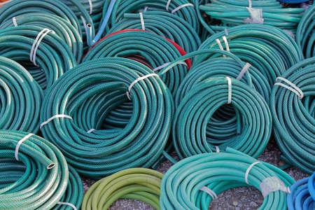 coils: Big bunch of green garden hose coils Stock Photo